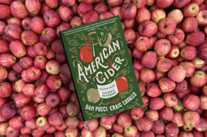 cider book on background of red apples
